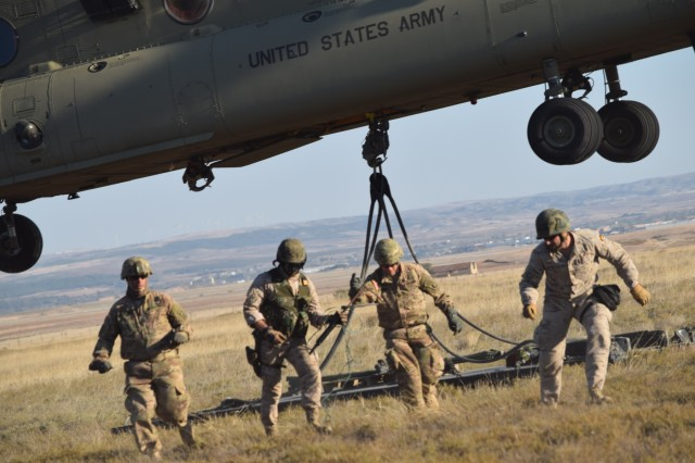 Soldiers from the U.S. Army 173rd Airborne Brigade along with 8th Battalion Spanish Legion Brigade, secure a pallet to a CH-47 Chinook, Oct. 30, 2015, during a combined exercise known as Trident Juncture in Chinchilla, Spain. The 173rd Airborne Brigade is the U.S. Army Contingency Response Force in Europe and is capable of deploying ready forces to conduct the full range of military operations across the U.S. European, Africa and Central Commands' areas of operations within 18 hours. (U.S. Army photo by 2nd Lt. Richard Hinman)
