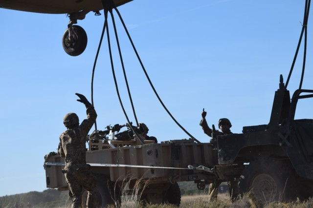 Soldiers from the U.S. Army 173rd Airborne Brigade along with 8th Battalion Spanish Legion Brigade, secure a trailer to a CH-47 Chinook, Oct. 30, 2015, during a combined exercise known as Trident Juncture in Chinchilla, Spain. The 173rd Airborne Brigade is the U.S. Army Contingency Response Force in Europe and is capable of deploying ready forces to conduct the full range of military operations across the U.S. European, Africa and Central Commands' areas of operations within 18 hours. (U.S. Army photo by 2nd Lt. Richard Hinman)