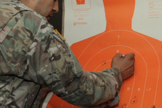 Spc. Fernando Escobedo, 169th Engineer Battalion, marks his target during competition for the German Army proficiency badge.