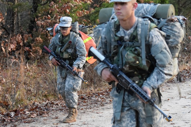 Pvt. Abrianna Moore marches with her platoon as part of the 24 kilometer ruck march during the Combat Engineer Field Training Exercise near the end of Combat Engineer Advanced Individual Training. She will become the first female combat engineer when she graduates One Station Unit Training.