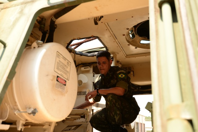 Brazilian army officer Maj. Guilherme Arauso Bittencourt thoroughly inspects an M88 A1 Medium Recovery Vehicle during a joint visual inspection (JVI) at Anniston Army Depot Aug. 28. Bittencourt selected several M88s to add to the Brazilian fleet.