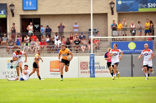 U.S. Army World Class Athlete Program rugby player 1st Lt. William Holder scores one of his two tries during all-Army's 43-12 victory over all-Air Force in the gold-medal match of the 2015 Armed Forces Rugby Championships at Infinity Park in Glendale, Colo.