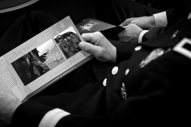 Retired Capt. Florent Groberg was inducted into the Pentagon's Hall of Heroes, Nov. 12, 2015, for conspicuous gallantry in Asadabad, Kunar Province, Afghanistan,  Aug. 8, 2012. An attendee reads the details of the actions that took place on that day.