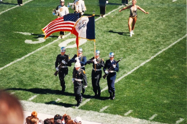 Lt. Col. Brad Cook (left), inspector general, U.S. Army Sustainment Command, post the colors in a joint color guard during a Hawkeye football game in Kinnick Stadium, Iowa City, Iowa, circa 1992. (Courtesy photo)