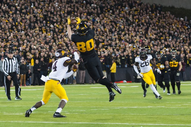 University of Iowa senior Henry Coble catches a pass during the now 10-0 Hawkeyes' historic 40-35 victory over the Minnesota Golden Gophers at Kinnick Stadium, Iowa City, Iowa, Nov. 14. (Photo by Kevin Fleming, ASC Public Affairs)