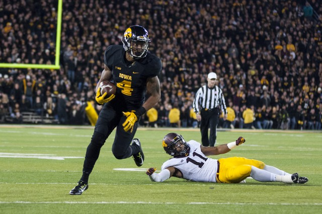 University of Iowa senior Tevaun Smith runs to within one yard of a touchdown after thatching a pass during the 10-0 Hawkeyes' historic 40-35 victory over the Minnesota Golden Gophers at Kinnick Stadium, Iowa City, Iowa, Nov. 14. (Photo by Kevin Fleming, ASC Public Affairs)