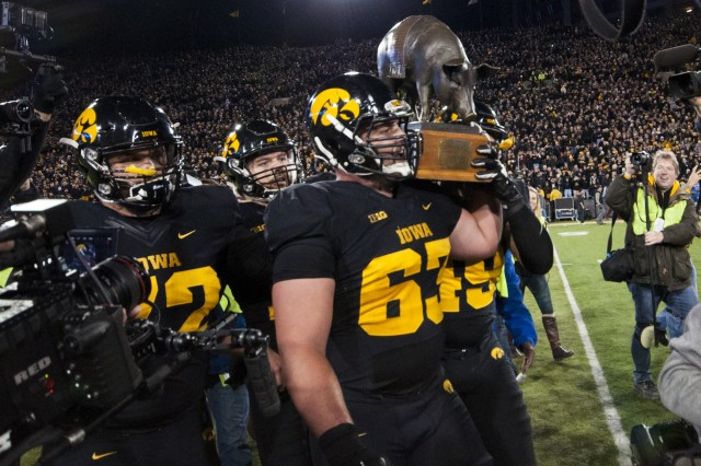University of Iowa players carry the Floyd of Rosedale trophy off the field after the now 10-0 Hawkeyes' historic 40-35 victory over the Minnesota Golden Gophers at Kinnick Stadium, Iowa City, Iowa, Nov. 14. (Photo by Kevin Fleming, ASC Public Affairs)