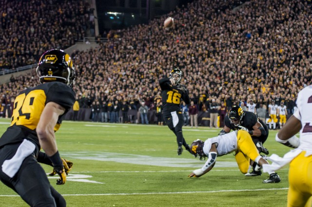 University of Iowa junior C. J. Beathard throws a pass that is caught by senior Travis Perry during the now 10-0 Hawkeyes' historic 40-35 victory over the Minnesota Golden Gophers at Kinnick Stadium, Iowa City, Iowa, Nov. 14. (Photo by Kevin Fleming, ASC Public Affairs)