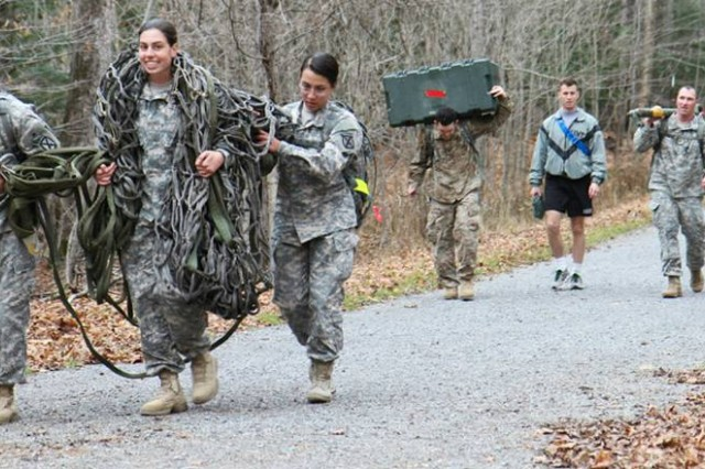 "Soldiers assigned to 2nd Brigade Combat Team ""Commandos,"" move military equipment though a 2-mile trail to compete for the best time during an eight station Commandos Veteran Day challenge Nov.11, on Fort Drum."