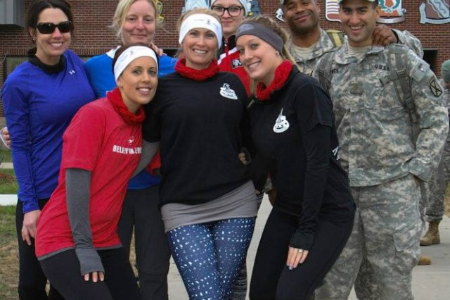 "Soldiers and spouses from the 2nd Brigade Combat Team ""Commandos,"" pose for a photograph before the start of the Commandos Veterans Day challenge Nov. 11, on Fort Drum. ""I think it's awesome that this event gives us a time to all come together,"" said Misty Bruce, spouse. ""It's wonderful that the Army offers us these opportunities to do things as a community, while our soldiers are deployed."""