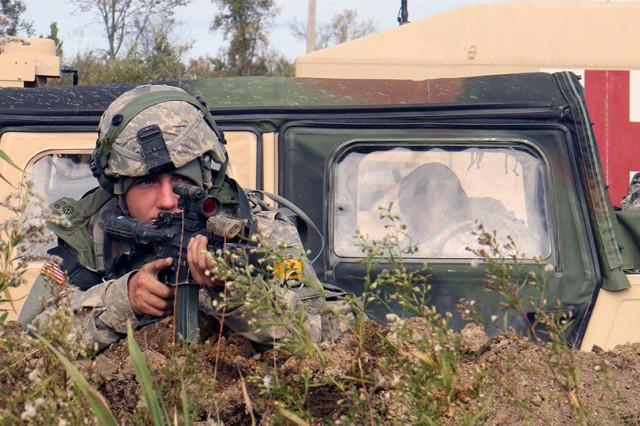 A Soldier assigned to 2nd Battalion, 87th Infantry Regiment, 2nd Brigade Combat Team, watches for enemy movement during a live-fire training exercise dubbed Catamount Peak held Oct. 6 on Fort Drum.
