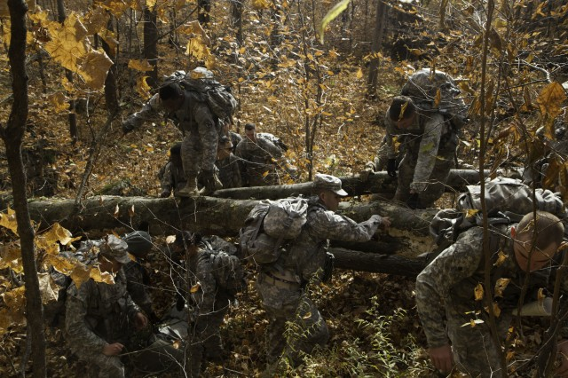 Soldiers assigned to C Company, 210th Brigade Support Battalion, 2nd Brigade Combat Team, carry a medical sled with 185 pound medical mannequin Nov. 5, during their Rough Terrain Evacuation Course held at Camp Ethan Allen Training Site, Jericho, Vermont.