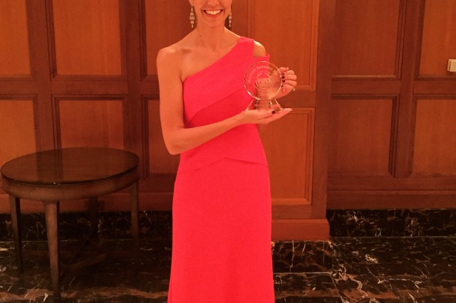 Melissa Morgan proudly displays her WID Horizon Industry Award for Innovation during the WID-MI Black Tie Gala, in Rochester, Mich. earlier this month.