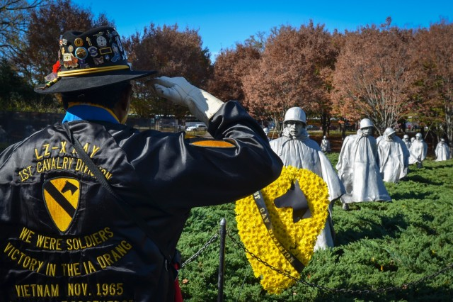 Ed Times, a veteran of the Battle of Ia Drang Valley, salutes after placing a wreath at the Korean War Memorial on Veterans Day 2015. A member of the mortar platoon with Company B, 1st Battalion, 7th Cavalry Regiment, 1st Cavalry Division, Times has been placing wreaths in Washington, D.C. every Veterans Day for the past 20 years.