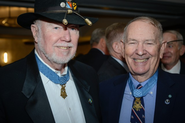 "Medal of Honor recipients retired Col. Bruce Crandall and retired Col. Walter Joseph ""Joe"" Marm pose for a photo at a banquet commemorating the 50th anniversary of the Battle of Ia Drang Valley, Nov. 14, 2015."