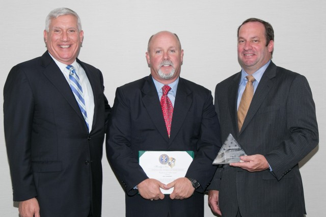 Lee V. McKinney (center), an intelligence security professional with INSCOM's 470th MI Brigade at Fort Sam Houston, Texas, accepts the U.S. Army Intelligence and Security Command's 2015 Maria V. Dunn Award for Security Excellence from Charles Sardo (left), INSCOM deputy chief of staff, and James K. McAlary, INSCOM's chief intelligence security officer, during an award ceremony held at Fort Belvoir, Virginia, Aug. 11.