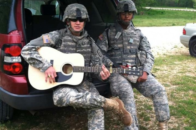 Then Pvt. 1st Class Jeffrey McCormick, assigned to the 50th Multi Role Bridge Company, 5th Engineer Battalion, strums his guitar during an organizational event.