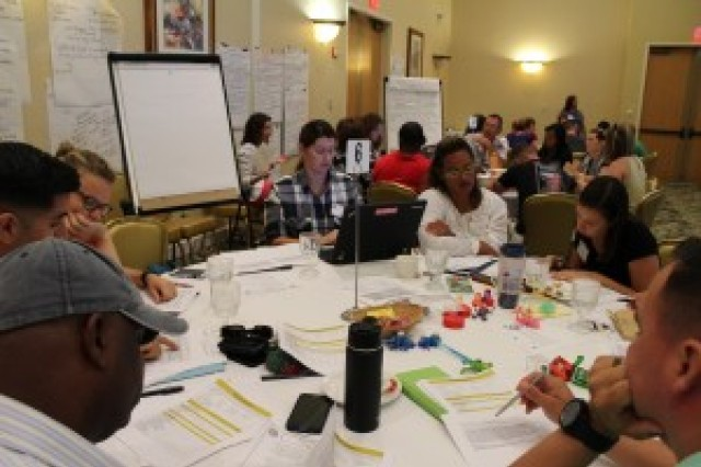 Groups of delegates work together on issues at the AFAP conference, Nov. 16-17.