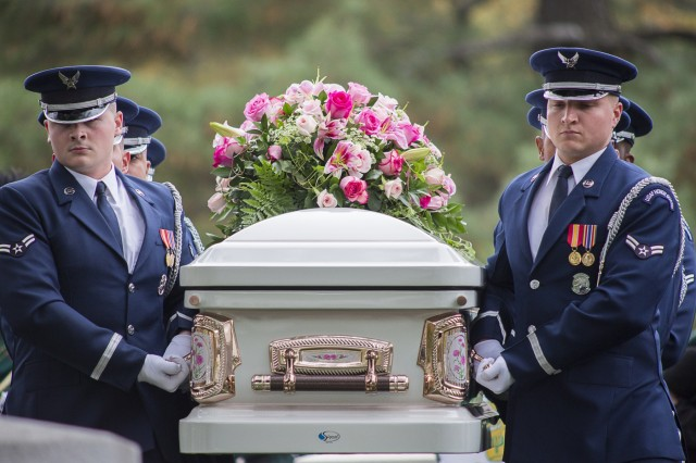 """U.S. Air Force Honor Guard casket team carry the casket of actress Maureen O'Hara to her burial site at Arlington National Cemetery Nov. 9 in Arlington, Va. O'Hara an acclaimed Hollywood actress, starting in such films as, """"Miracle on 34th Street,"""" """"Only the Lonely"""" and """"The Quiet Man,"""" passed away Oct. 24 in Boise, Idaho. The screen legend was laid to rest next to her husband, U.S. Air Force Brig. Gen. Charles F. Blair. (Joint Base Myer-Henderson Hall PAO photo by Nell King)"""