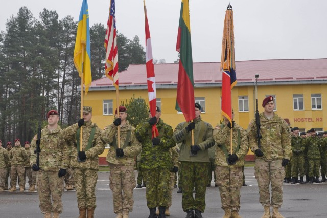 Soldiers with Joint Multinational Training Group-Ukraine present colors of participating nations during the Fearless Guardian II opening ceremony under Joint Multinational Training Group-Ukraine at the International Peacekeeping and Security Center near Yavoriv, Ukraine, Nov. 23, 2015.