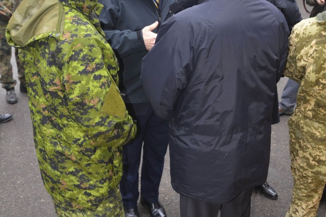 Geoffrey R. Pyatt, U.S. ambassador to Ukraine, talks to Roman Waschuck, the ambassador of Canada to Ukraine, during the Fearless Guardian II opening ceremony under Joint Multinational Training Group-Ukraine at the International Peacekeeping and Security Center near Yavoriv, Ukraine, Nov. 23, 2015.