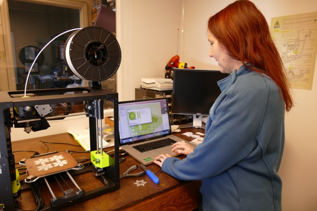 Janice Booth, AMRDEC electronics engineer creates snowflakes on a 3D Printer