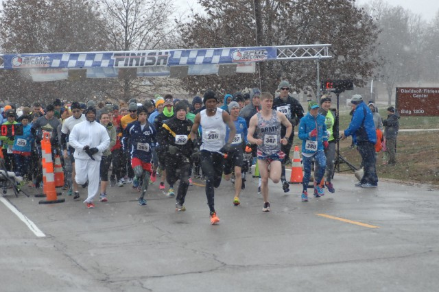 Amid falling snow, runners begin the annual Turkey Trot 5k/10k run Saturday at Davidson Fitness Center. Nearly 150 runners participated in the annual race, which awards turkeys to the first-place winners in each age category.