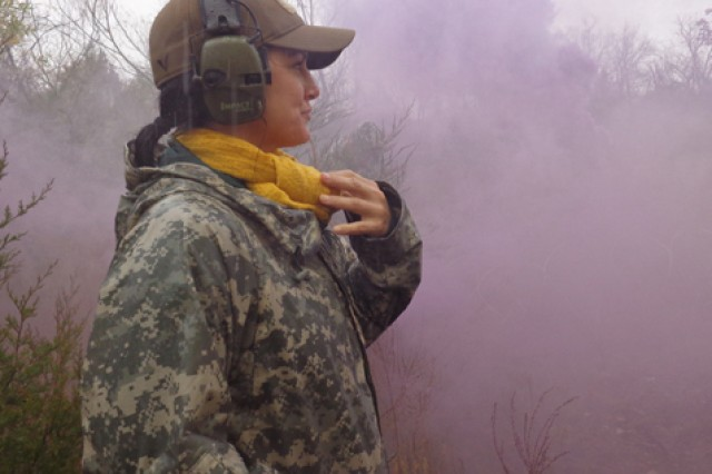 Carano observes a field training exercise during her visit to Fort Leonard Wood.