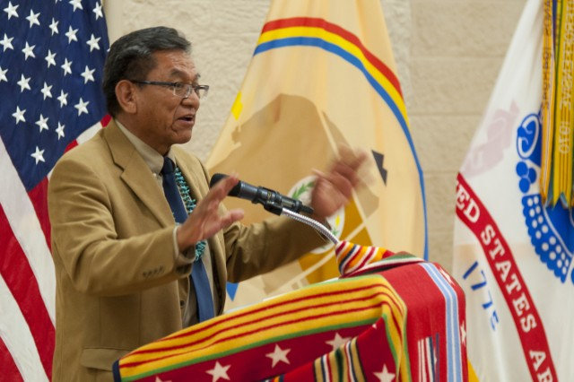 Russell Begaye, Navajo Nation president, talks about his nation's culture of honoring veterans during his keynote speech at Rock Island Arsenal's Native American Month observance in Illinois, Nov. 24th. (Photo by Kevin Fleming, ASC Public Affairs)