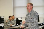 Sgt. 1st Class Marion Fox teaches a block of instruction to his fellow classmates as part of his training for phase 1 of the 94th Training Division's Finance Senior Leaders Course at Fort Dix, New Jersey.