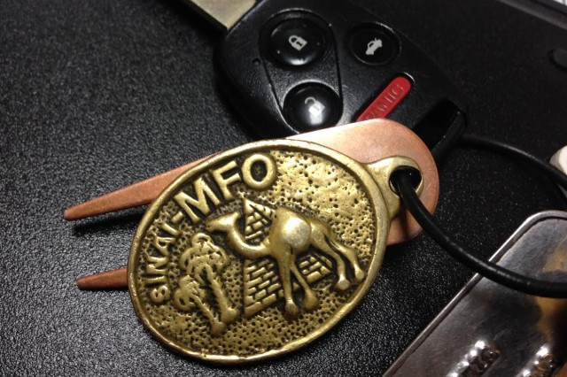 While on a peacekeeping mission in the Sinai, Maj. Michael Lawrence sent a Multinational Force and Observance key fob to Joe Hirsch, who worked under Lawrence at Fort Campbell Public Affairs. Lawrence was one of the Soldiers aboard the Arrow Air Flight 1285 that crashed in Gander, Newfoundland Dec. 12, 1985. Hirsch keeps the memento to this day in honor of his friend and mentor.