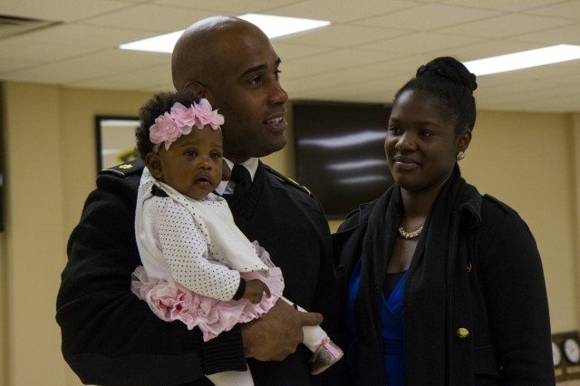 Maj. Micah Ramseur, a logistics officer with the 200th Military Police Command, reflects on his career during his promotion ceremony Nov. 24, at a U.S. Army Reserve center at Fort Meade, Md. Of Baltimore, Ramseur stressed the importance of family and the roles they play in a Soldier's career during his promotion speech. (U.S. Army photo by Sgt. Marc Loi)