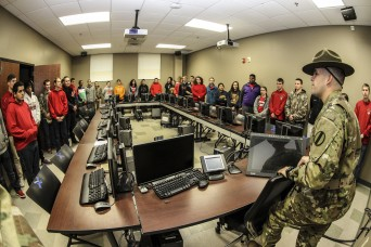 Sgt. 1st Class Eugene Serrano, USADSA drill sgt. leader, gives a tour to a group of cadets with the South Point High School Navy Junior ROTC program of the Drill Sgt. Academy at Fort Jackson, S.C., Nov. 24, 2015. The cadets were there on a one-day visit to learn citizenship and patriotism but also see the day-to-day operations of the other services. (U.S. Army photo by Sgt. 1st Class Brian Hamilton)