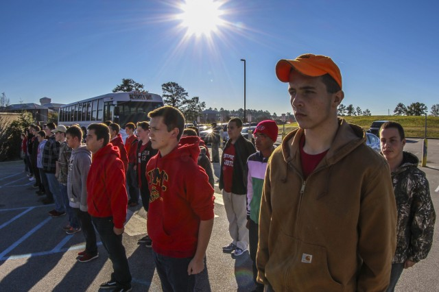 Cadets from the Navy Junior ROTC program at South Point High School in North Carolina stand at attention while waiting on a drill sergeant with the United States Army Drill Sergeant Academy to take them on a guided tour of the Academy grounds at Fort Jackson, S.C., Nov. 24, 2015. (U.S. Army photo by Sgt. 1st Class Brian Hamilton)