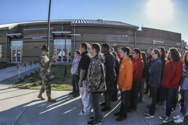 Sgt. 1st Class Eugene Serrano, USADSA drill sgt. leader, gives a tour to a group of cadets with the South Point High School Navy Junior ROTC program of the Drill Sergeant Academy at Fort Jackson, S.C., Nov. 24, 2015. The cadets were there on a one-day visit to learn citizenship and patriotism but also see the day-to-day operations of the other services. (U.S. Army photo by Sgt. 1st Class Brian Hamilton)