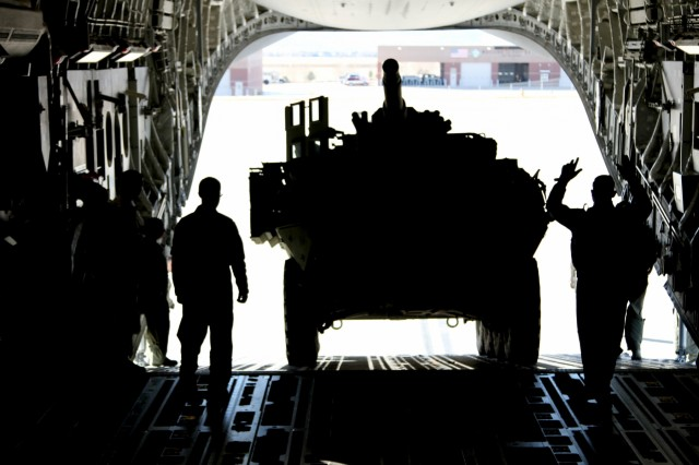 Soldiers, Airmen partner for Mobile Gun System Stryker air mobility