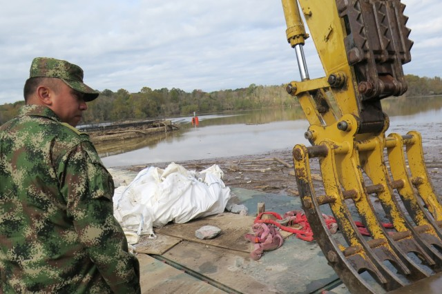Colombian army Lt. Andres Duarte surveys flood damage at the Columbia Canal in South Carolina, Nov. 17, 2015. The South Carolina National Guard held a subject matter expert exchange with its partner nation, Nov. 15 - 21, 2015.