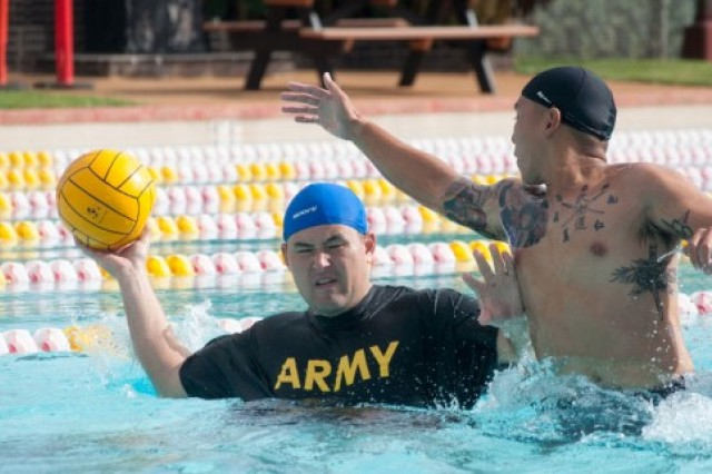 Staff Sgt. Patrick Nunnery, Bravo Company cadre, fends off a Marine Defender during the Army vs. Marines water polo game on Nov. 12th. Army swept all three games, but both units fought hard.