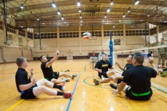 Sgt. 1st Class Joey Sabey, Bravo Company Soldier in transition, returns a volley during an inter-Army seated volleyball tournament, Nov. 10, at Martinez Gym.