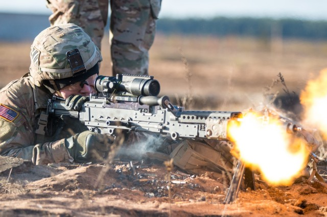 Spc. Timmy Racke, an infantryman with the 3rd Battalion, 69th Armor Regiment, 1st Armor Brigade Combat Team, 3rd Infantry Division, engages targets with his M240B Machine Gun while conducting battle drills at Pabrade Training Area, Lithuania, Dec. 2, 2015.