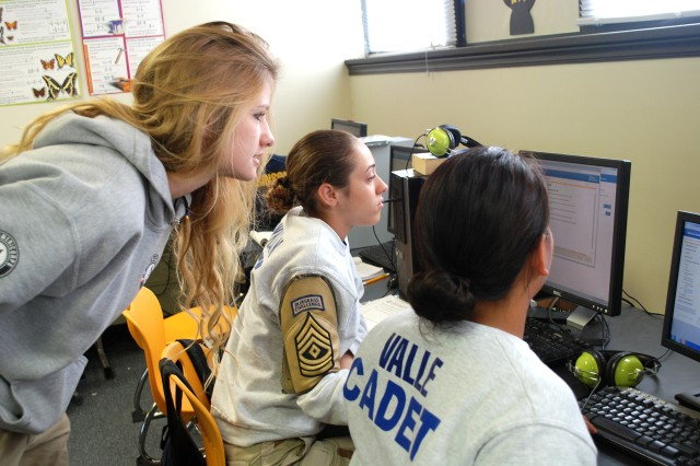 ASHLEY MCCANE, A NURSE WHO IS PARTICIPATING IN THE AMERICORPS PROGRAM, answers questions from cadet 1st Sgt. Lily Bowman of Elizabethtown, and Vianey Valle of Lexington. McCane said she joined AmeriCorps because she was interested in the Peace Corps and thought she would try projects in the U.S. first.