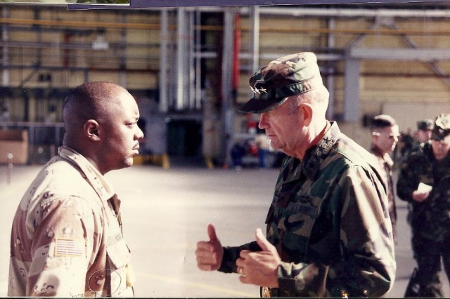 Retired Sgt. 1st Class Philip Mims, then an infantry platoon sergeant with 2nd Battalion, 22nd Infantry Regiment, at Fort Drum, receives a final briefing from Army Chief of Staff Gen. Gordon Sullivan in October 1993, before his deployment to Somalia.