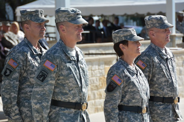 Gen. Daniel B. Allyn, Army vice chief of staff, and Lt. Gen. Patricia D. Horoho, commander of U.S. Army Medical Command, stand at attention.