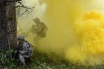 U.S. Army Soldiers with 2nd Battalion, 3rd Infantry Regiment, 1-2 Stryker Brigade Combat Team, move through concealing smoke during training at Joint Base Lewis-McChord, Wash., Nov. 5, 2015. During the nearly weeklong training, the Soldiers honed their teamwork skills as they practiced fighting simulated enemies in an urban setting. (U.S. Army photo by Staff Sgt. Justin Naylor, 1-2 Stryker Brigade Combat Team Public Affairs)