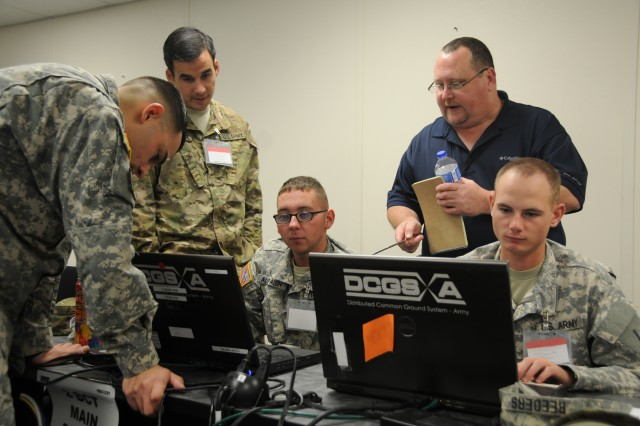 Soldiers take an early look at the Command Post Computing Environment (CP CE) v2 during a Risk Reduction Evaluation (RRE) event at Ft. Bliss, TX, Nov. 19, 2015. The event is responsible for soldier training and evaluation of CP CE version two, a web-based widget system that consolidates and simplifies separate capabilities commanders use for missions related to all the warfighting functions. (U.S. Army photo by Devon Bistarkey / Released)