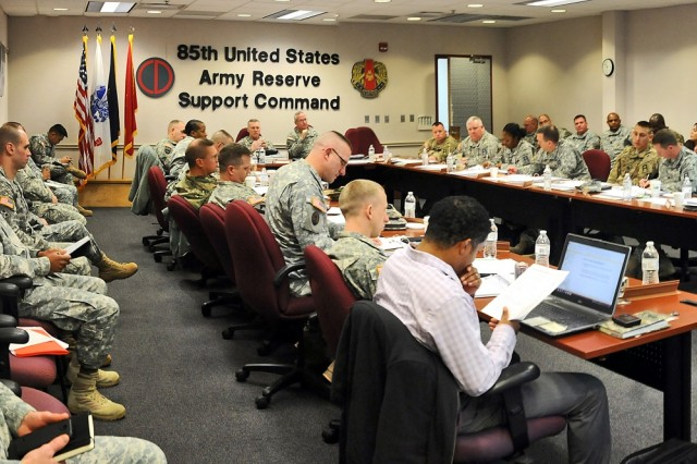 Command staff members from First Army, 85th Support Command and First Army brigade teams participate in the First Army brigade executive officers brief, Dec. 4. The purpose of the briefing was to assist the active component brigades better understand the different processes within their Army Reserve battalions, and improve communications between the active and reserve units assigned to the brigades. (U.S. Army photo by Spc. David Lietz/Released)