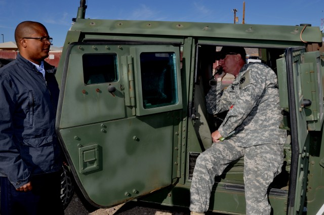 Lt. Col. Matthew D. Owens, National Training Center's director of instrumentation, listens to a radio transmission signal disrupted by the Threat Systems Management Office direct inject jammer.