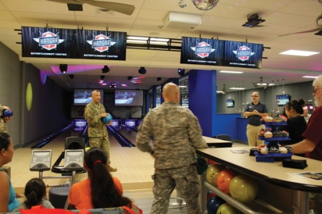 Soldiers get ready to bowl the first game at the grand opening celebration of the Hangar Entertainment Center, Wednesday.