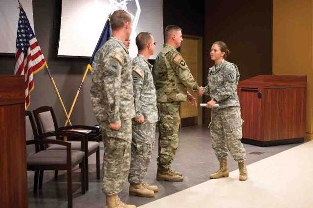 2nd Lt. Melanie P. Hindley accepts a certificate during the Bradley Leader Course graduation Dec. 4 at Long hall. Hindley is the first female to graduate from the course. For more photos, visit http://tiny.cc/5xp26x.