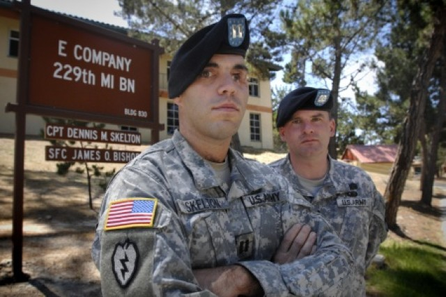 Before returning to command the 2nd Stryker Cavalry Regiment in Afghanistan, then-Army Capt. D.J. Skelton, left, is pictured with his first sergeant, Sgt. 1st Class James O. Bishop, while in command of Company E, 229th Military Intelligence Battalion. In Iraq in 2004, Skelton sustained grave injuries, and he fought for several years to stay on active duty and return to command in combat.